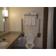 Handicap commode in handicap suite with roll in shower