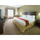 king guest room with work desk