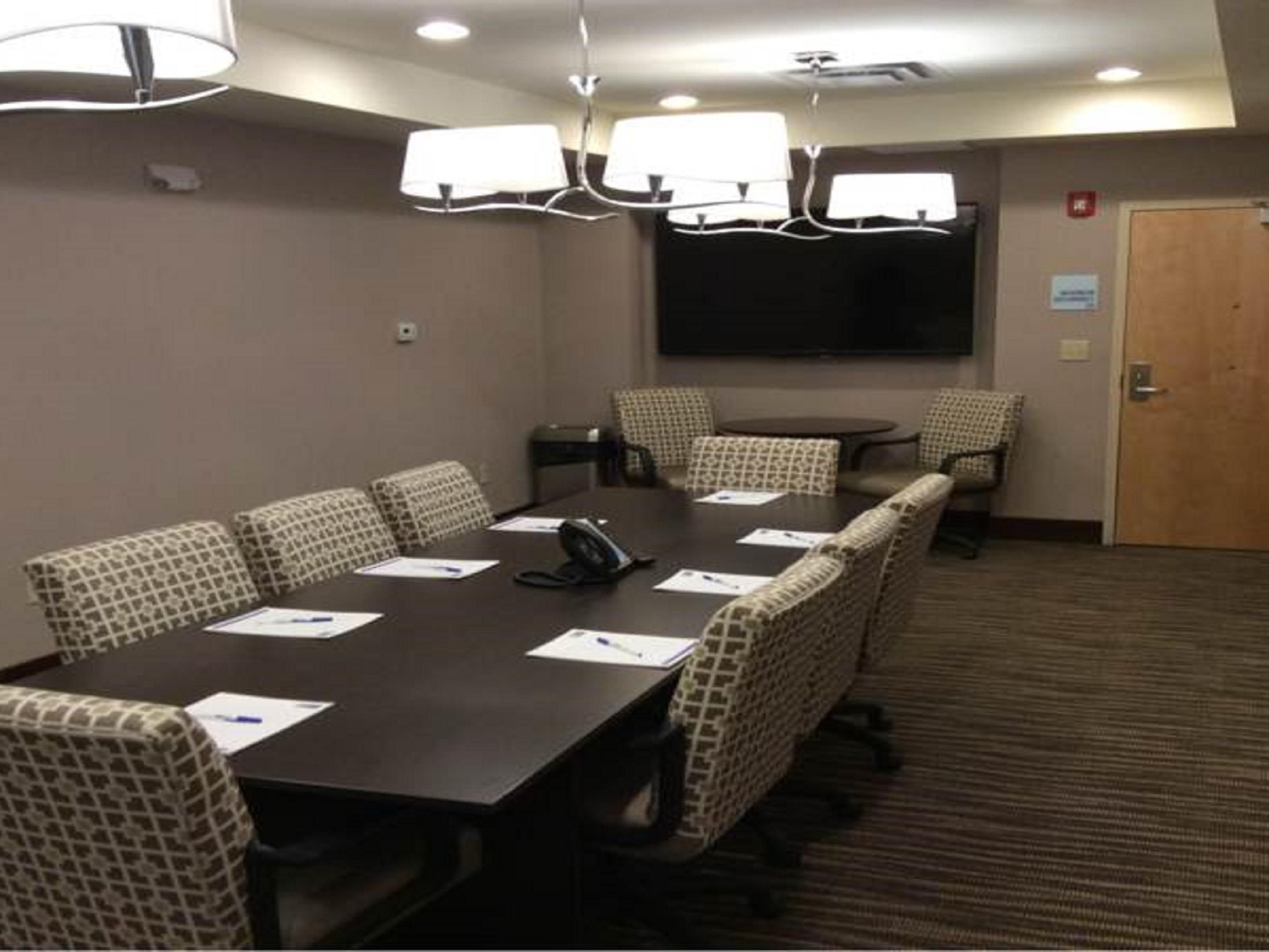 Board style meeting room equipped with Smart TV