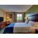 Rest easily in a comfortable king bed guest room