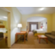 Our Family Suite has 4 queen beds!  Separate bedroom has 2 beds.