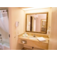 Guest Bathroom with premium amenities and curved curtain rod