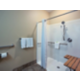 Well-equipped King ADA Bathroom with Roll-In Shower