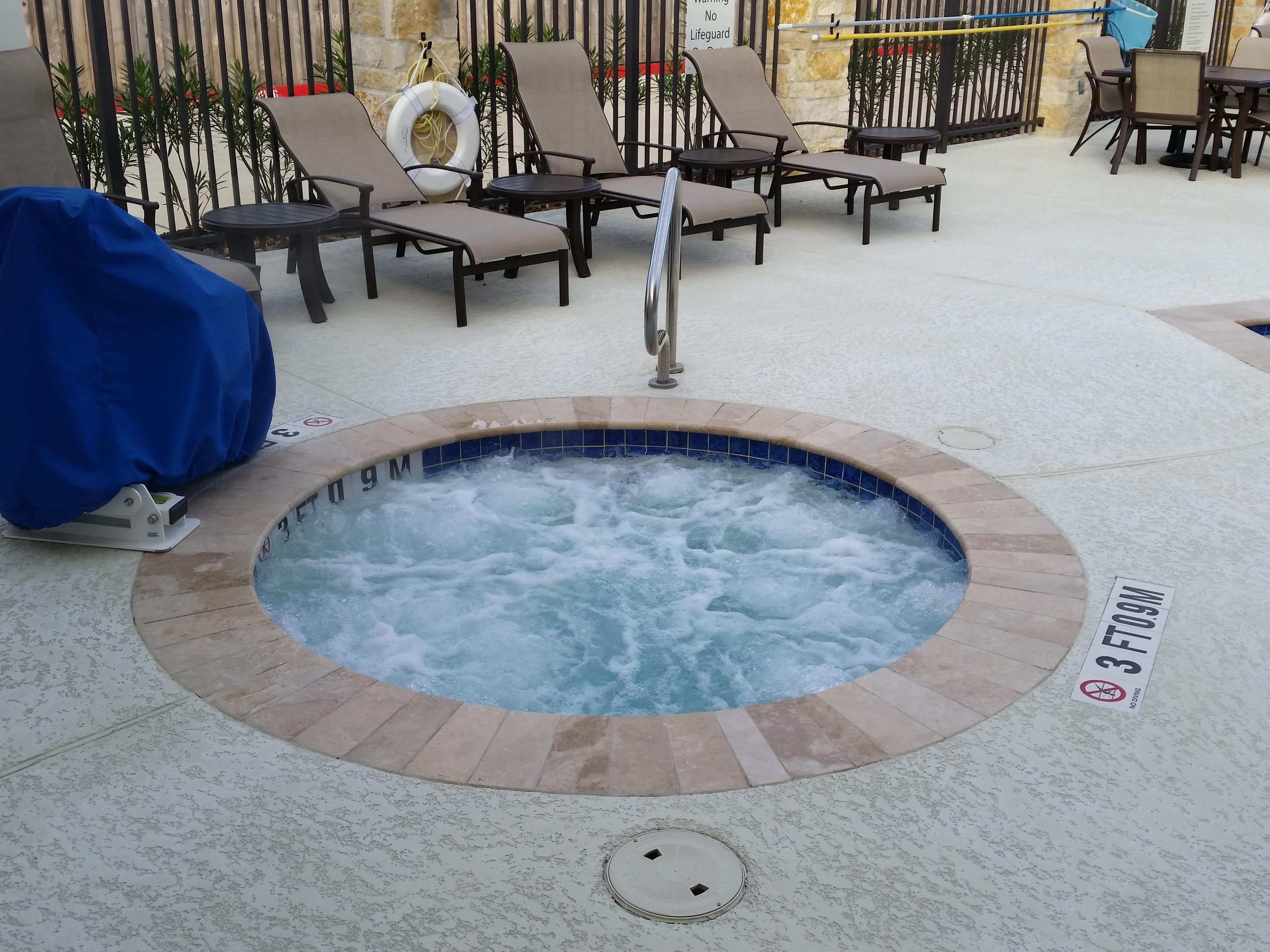 Soothe your tired muscles in our saltwater hot tub - open daily!