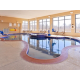Indoor heated pool with raised infinity pool