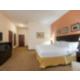Very spacious king bed guestroom.