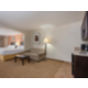 2 queen bed suite with sofa sleeper / sitting area