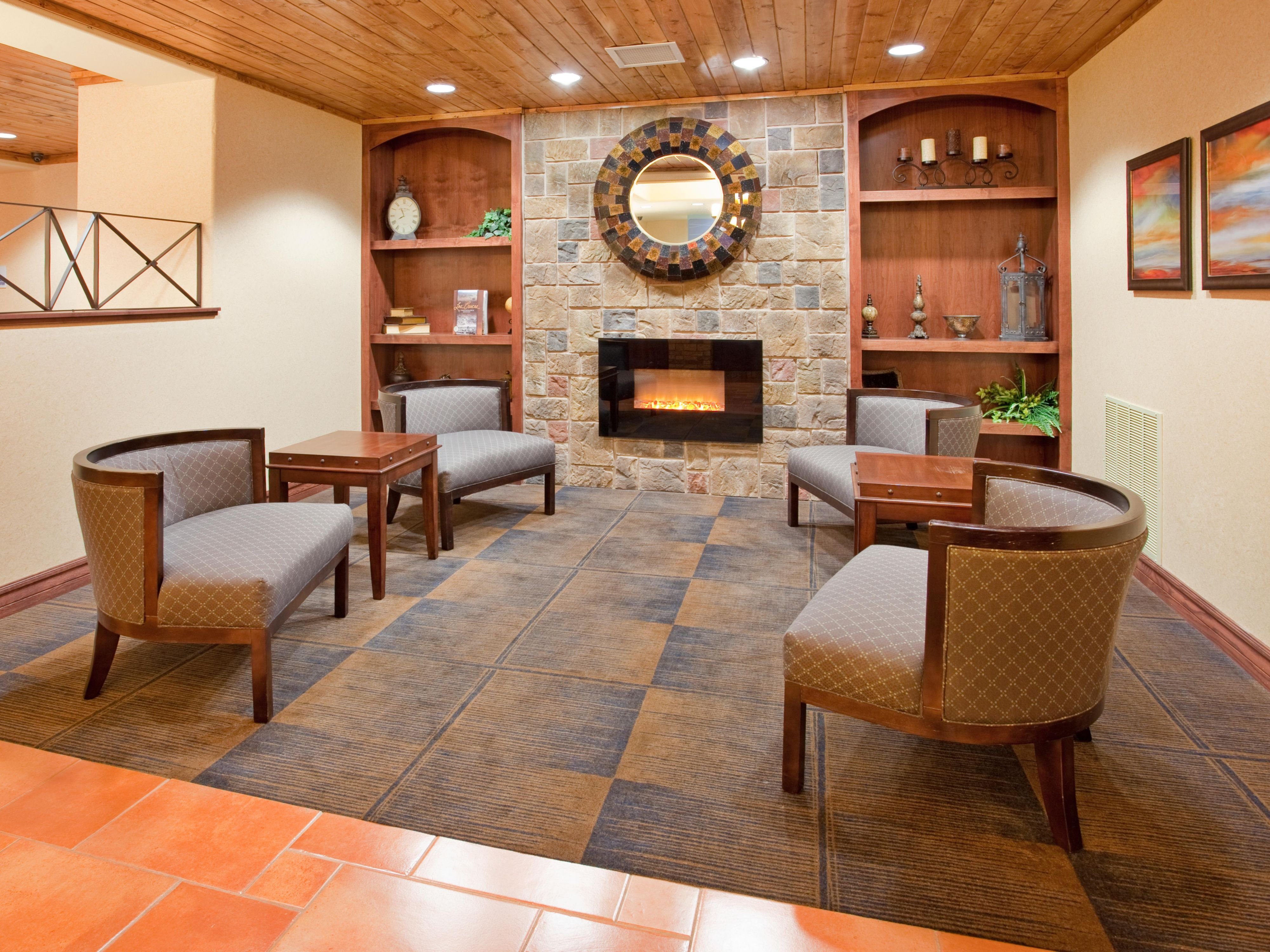 Have a seat by the fireplace in our cozy lobby.