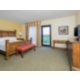 Childress Suite bedroom with king bed and second television