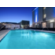 Outdoor Heated Swimming Pool with Hot Tub at Evening