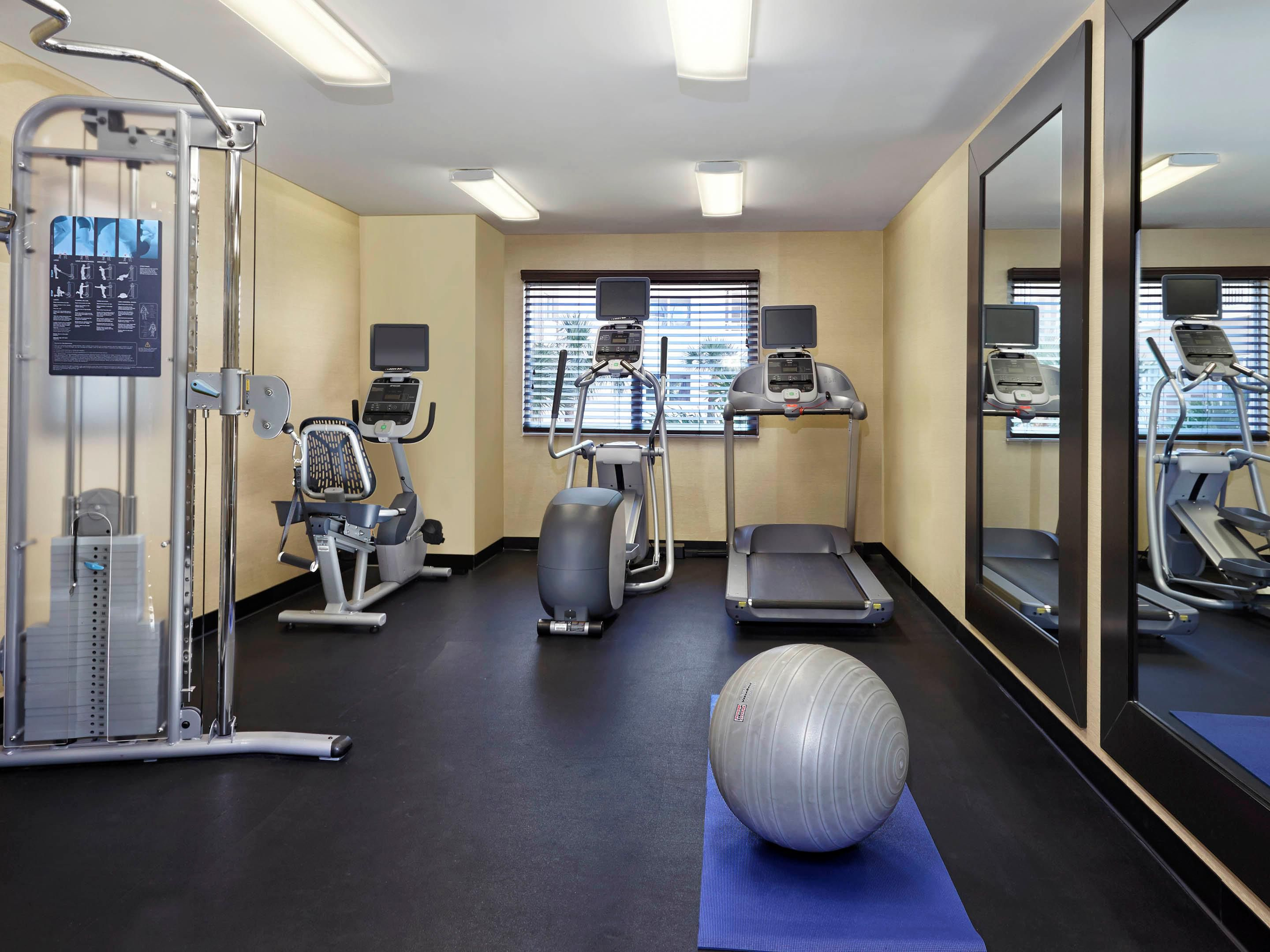 Enjoy a variety of equipment in our Fitness Center