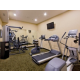 Complimentary fitness center with stationary weights.