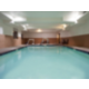 Heated indoor swimming pool with whirlpool.
