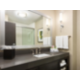 Guest Bathroom Featuring Blowdryer and Guest Amenities