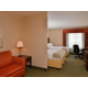 Relax in our one room suite with two queen beds and a sleep sofa