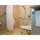 Wheelchair accessible bathroom in Standard King room.