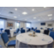 Meeting Room set in round tables for up to 54 people