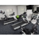 Fitness center with cardio and weight machines.