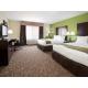 Relaxing Two Queen Bed Guest Room