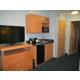 Wet bar area with door to bedroom in 2 room Suite