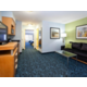 2 Queen Suite with separate living room and bedroom areas