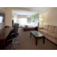 King suite with pullout sofa, fridge, microwave, and coffee maker.