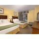 Double Queen Suite Bedroom Area with Balcony