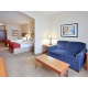 This room with two beds also features a sitting area.