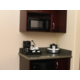 Cabinetry with food utensils, plates, cups in all guest room suite