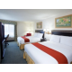 Relax in our 2 queen bed guest room.