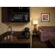 Feel more at home with a wet bar and lounge area in our suites