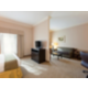 King Suites have TVs in both the Living Area and Bedroom Area