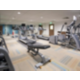 24 hour fitness center with treadmills and free weights