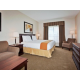 One King Bed Guest Room With A Seating Area