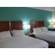 Our double rooms offer plush queen size beds!