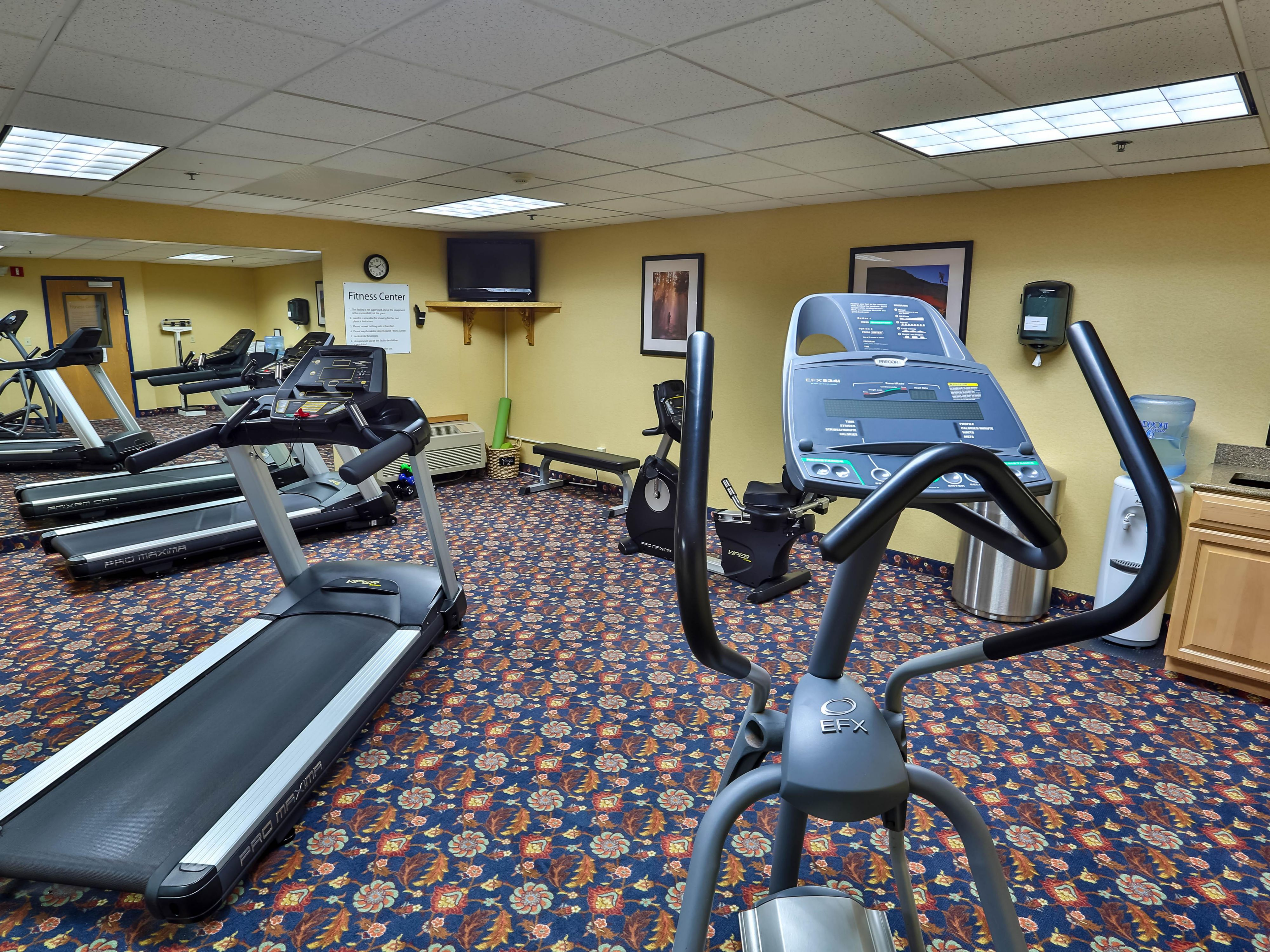 Features 2 Treadmills, an Elliptical Machine and Recumbent Bike