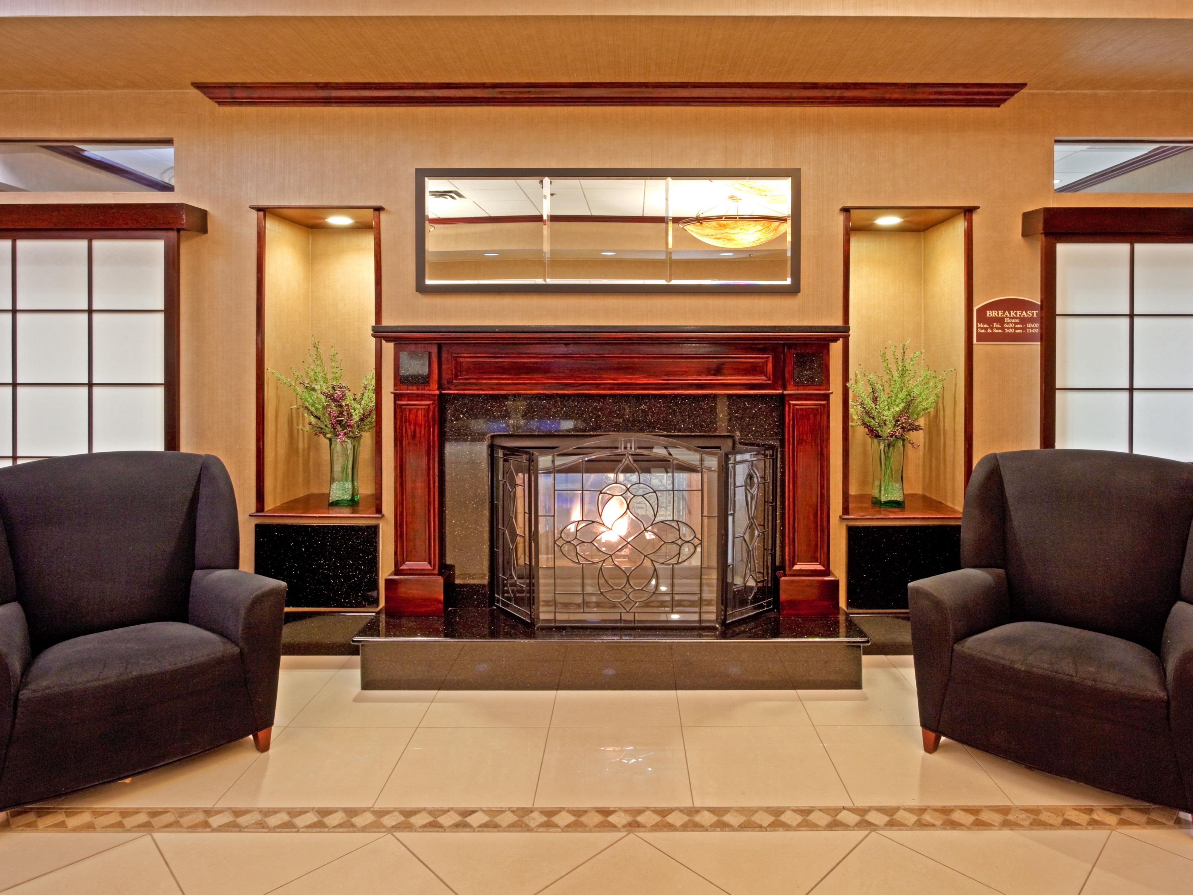 Relax and stay warm by our lobby fireplace