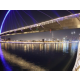 Catch the glimpse of the Blue Arc Bridge above Dubai Water Canal