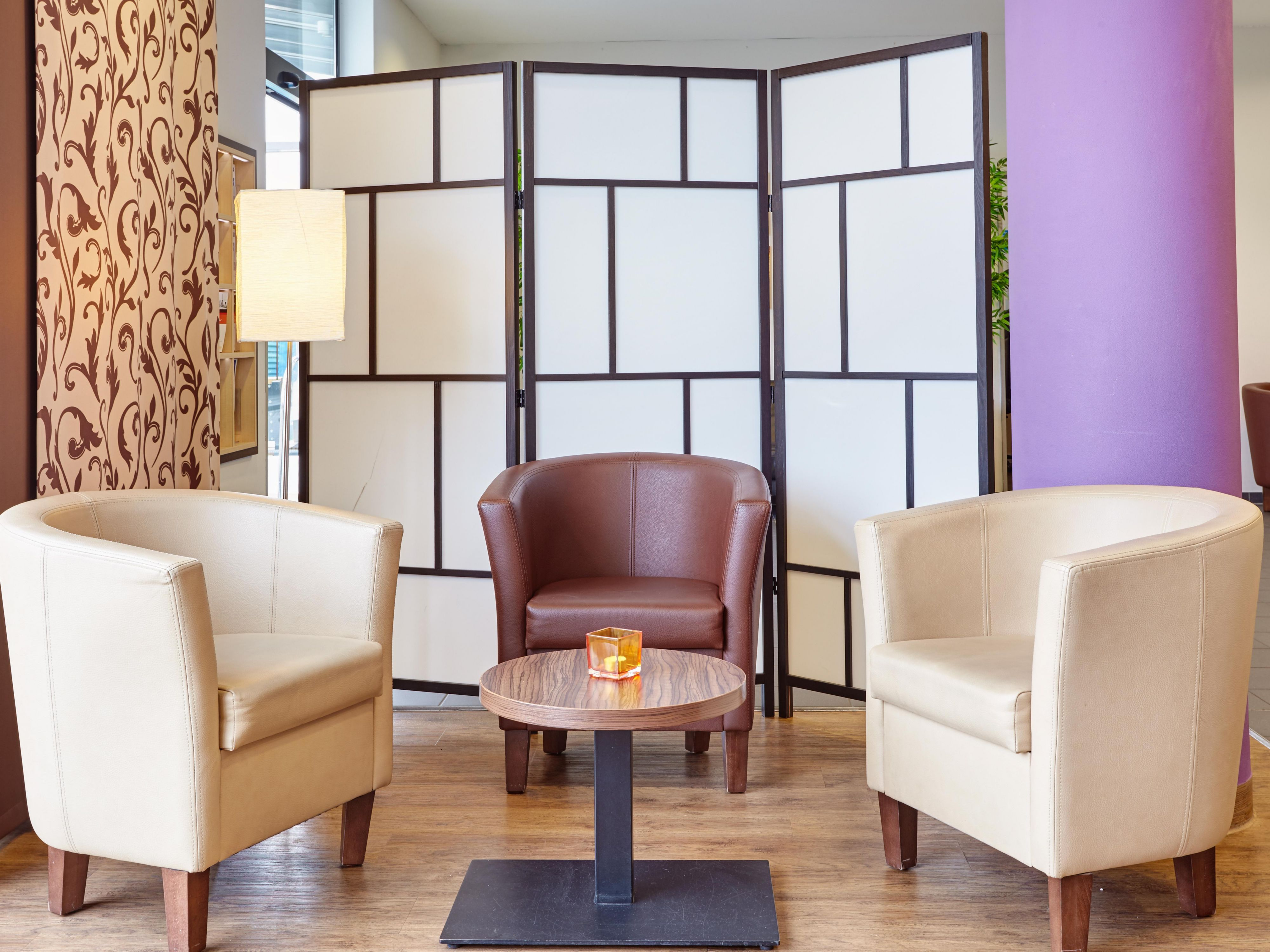 Kick back in our cozy Lobby Seating Area