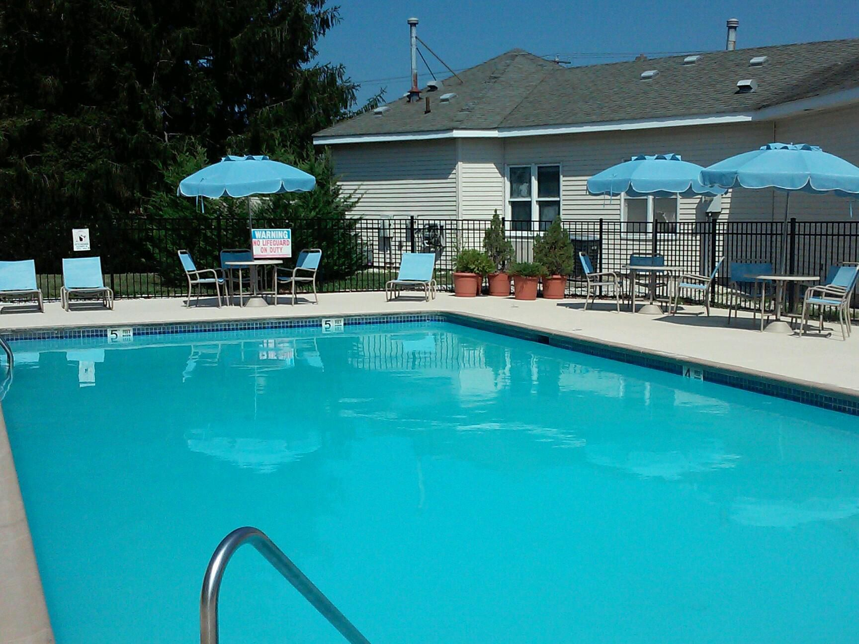 Relax by our Outdoor Swimming Pool