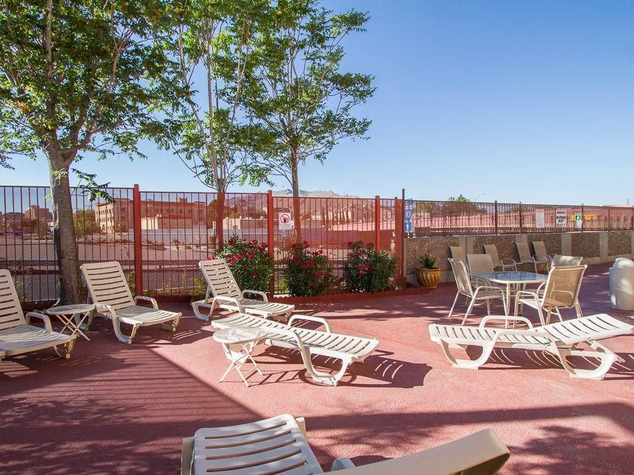 Catch some rays at our El Paso hotel swimming pool lounge area!