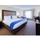 Rest easy in our King bed room featuring complimentary WIFI