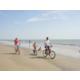 Biking on the beach is a fun family activity