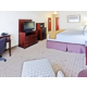 King room features large desk and flat panel television