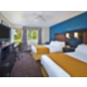 Two Room Deluxe Suite with One King and One Queen