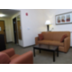 Generous Sitting Area Includes Pull Out Sofa and Easy Chair