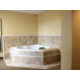 King Jacuzzi Suite, king bed and sleeper sofa