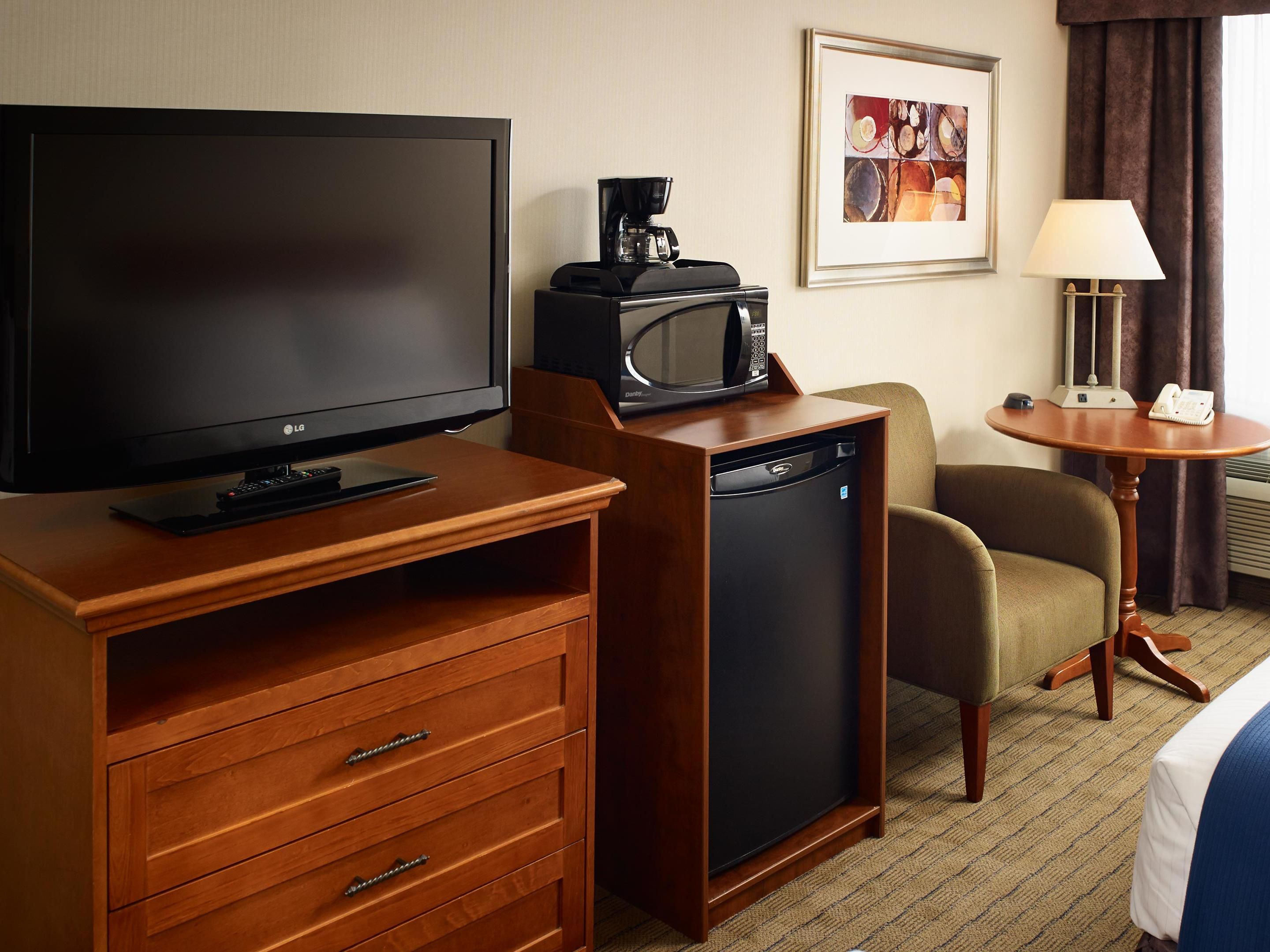 Room Amenities include a microwave, refrigerator and a big LCD TV