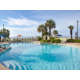 Take a dip in our heated pool overlooking the beautiful beach