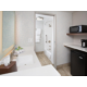 Guest bathroom area and entry including microwave and refrigerator